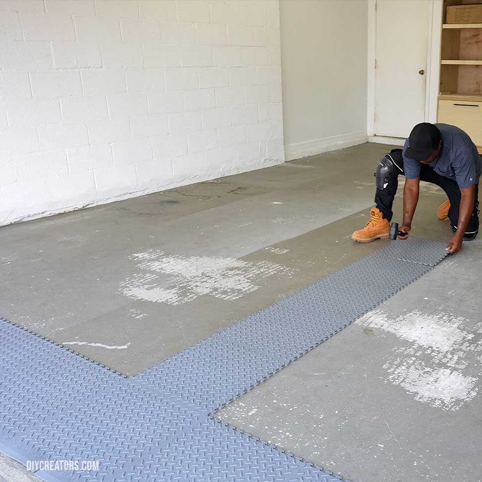 Create a T-shape with the Husky PVC tiles across the entrance and down the center of your garage