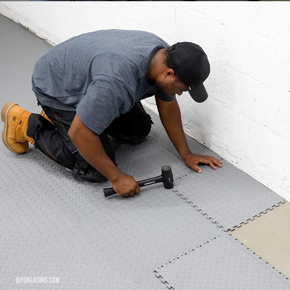 Lay out and connect the cut Husky PVC tiles along the wall to finish up