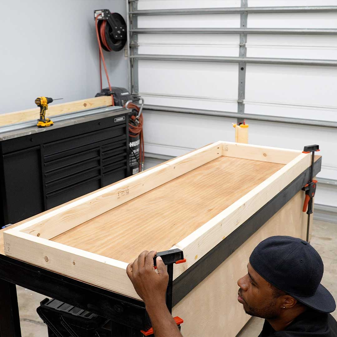 Using clamps to keep the wood together helps prevent pieces from shifting while drilling.