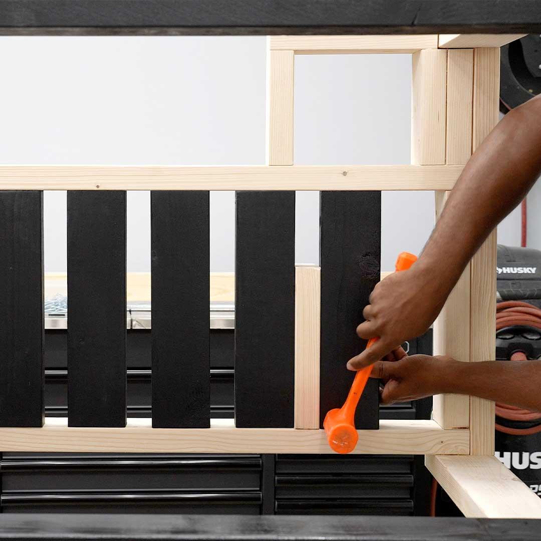 Use a 2x4 to space the workbench shelf  slats apart